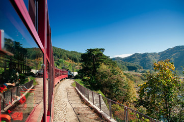 V-Train sightseeing train run along stream and valley of Gangwon-do, South Korea