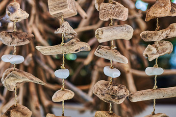 Fototapeta Background of natural driftwood mobiles hanging on the shop display on the blurred background.. Uses as decoration. Handicrafts of Bali at the famous Ubud market for sale. Handmade souvenirs. obraz