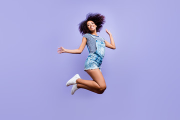Bottom view portrait of crazy positive girl in jeans outfit jump