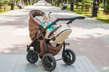little girl on a walk in a stroller. Products for children