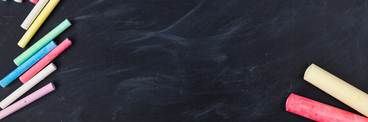 Dark chalk board with colored pencils for drawing. copy space