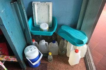 Containers filled with water are seen at the Central University of Venezuela hospital in Caracas