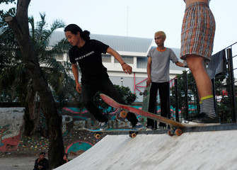 Youth skate at a skateboard park in Palembang