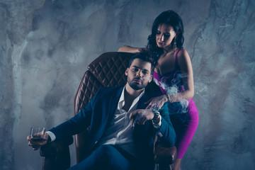 Portrait of rich gentleman in formal wear sitting in leather cha