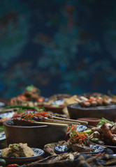 Freshly prepared delicious varieties of dishes on table. Many food dishes on table