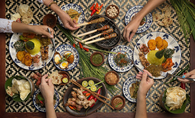 Served table top view, dinner. People eat food together. Top view of food and hands