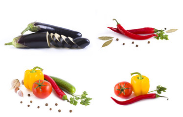 Red tomato and green cucumber. Bitter pepper with herbs and yellow pepper on a white background. Eggplant on a white background. Fresh vegetables on a white background.