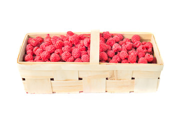 Wicker basket full of raspberries isolated on white background