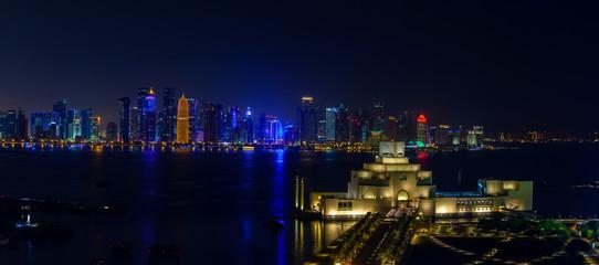 Doha Qatar night skyline panorama with Museum of Islamic Arts