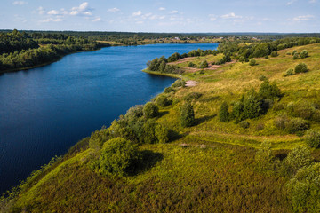 Bird's eye view of the Oyat river and green fields of Vepsia, the border with Karelia and Leningrad oblast, Russia.