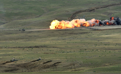 """A target is hit during a closing ceremony of the NATO-led military exercises """"Noble Partner 2018"""" at Vaziani military base outside Tbilisi"""