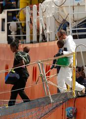 Migrants disembark from the humanitarian ship Aquarius at Boiler Wharf in Senglea, in Valletta's Grand Harbour