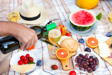 Summer Picnic Basket on the Green Grass. Food and drink concept. Friends Party time