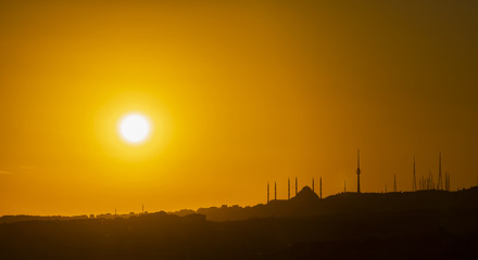 sunrise and mosque and city silhouette in istanbul