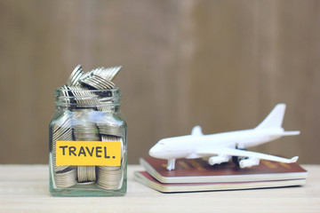 Saving planning for Travel budget of holiday concept,Financial,Stack of coins money in the glass bottle and airplane on passport