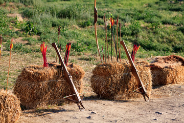 Crossbows, bow and arrows on the straw blocks