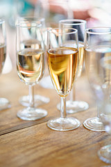 Champagne glasses on wooden table. Selective focus and shallow depth of field.
