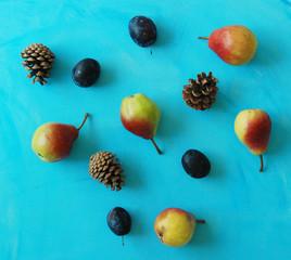 Autumn fruits on blue background.
