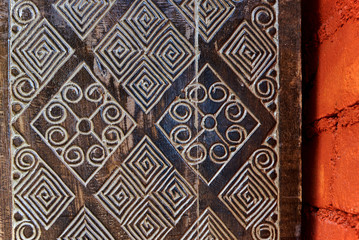 Detail of a wooden carved.  Old and vintage wooden part decorative panel. Handcrafted beautiful wooden carved.  Wooden pattern for decor. Intricate  wood crafted design. Abstract background.