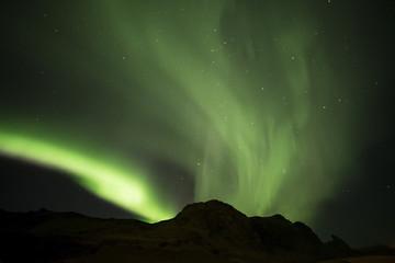 Aurora borealis  and Hrafnatindar mountain at Vik campground Iceland