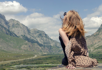 sitting girl in the mountains