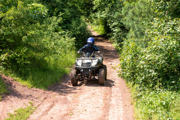 A trip on the ATV on the red road.