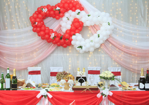 Festively decorated table of the bride and groom at the wedding