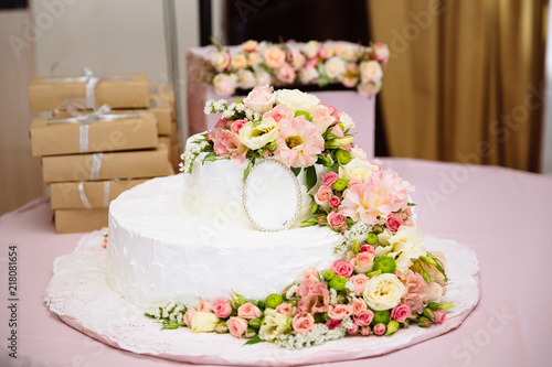 Close Up Photo Of A Wedding Cake Decorated With Fresh Flowers A