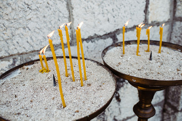 Candles in front of the Orthodox church burned for the souls of the deceased