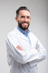 Smiling confident male doctor in a white lab coat