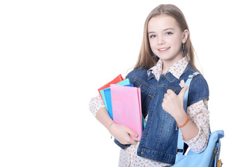Schoolgirl posing with books isolated on white background