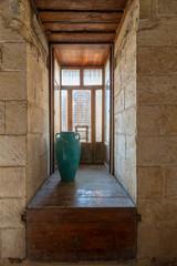 Recessed interleaved wooden window (Mashrabiya) and turquoise vase, Medieval Cairo, Egypt