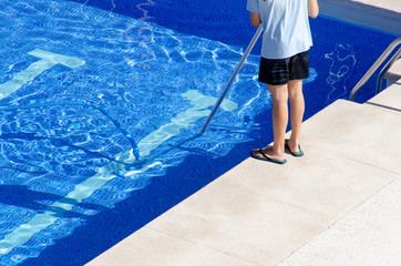 cleaning the swimming pool ground