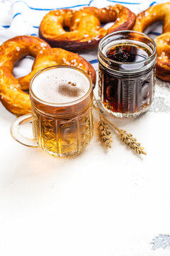 Beer and pretzels on white