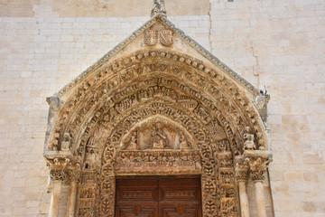 Italy, Puglia region, Altamura,  Cathedral of Santa Maria Assunta, gate and sculptures of the main façade.