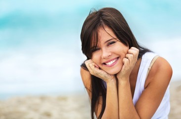 Portrait of a Smiling Woman at the Beach