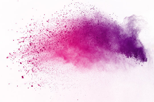 Abstract of colored powder explosion on white background. Multicolor powder splatted isolate. Colorful cloud. Colored dust explode. Paint Holi.