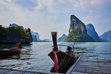 View point over bay with long tail boat in the ocean. Beautiful scenery with sea and mountains,  popular landmark, tourist destination of Southeast Asia. Active lifestyle concept.