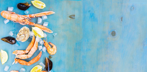 Fresh seafood border with copy space on blue background banner