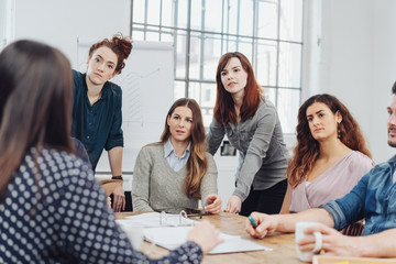 Group of young businesswomen listening attentively