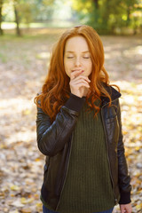 Young redhead woman pausing a moment to meditate