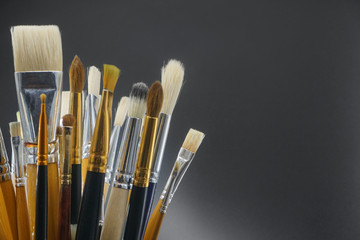 bouquet of brushes for drawing on a black background
