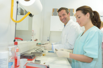 female and male scientist at medical lab