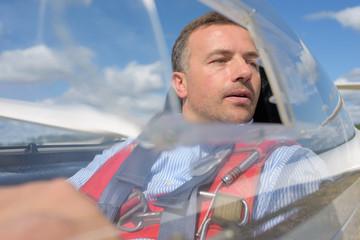 pilot inside cockpit of a small plane