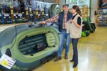 Man looking at inflatable boat in a shop