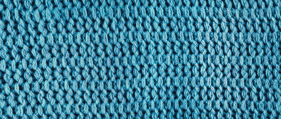 Knitted blue wool, panorama.