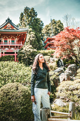 Smiling young woman standing near pagodas