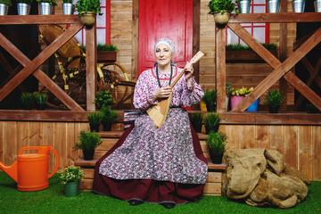 grandmother plays balalaika