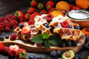 Traditional belgian waffles with fresh mint, sugar and raspberries.