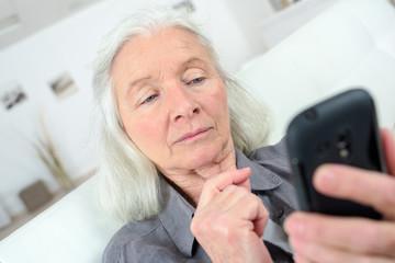Elderly woman using cellphone
